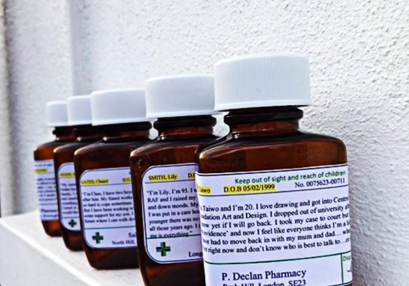 Pill bottles with social work stories printed on