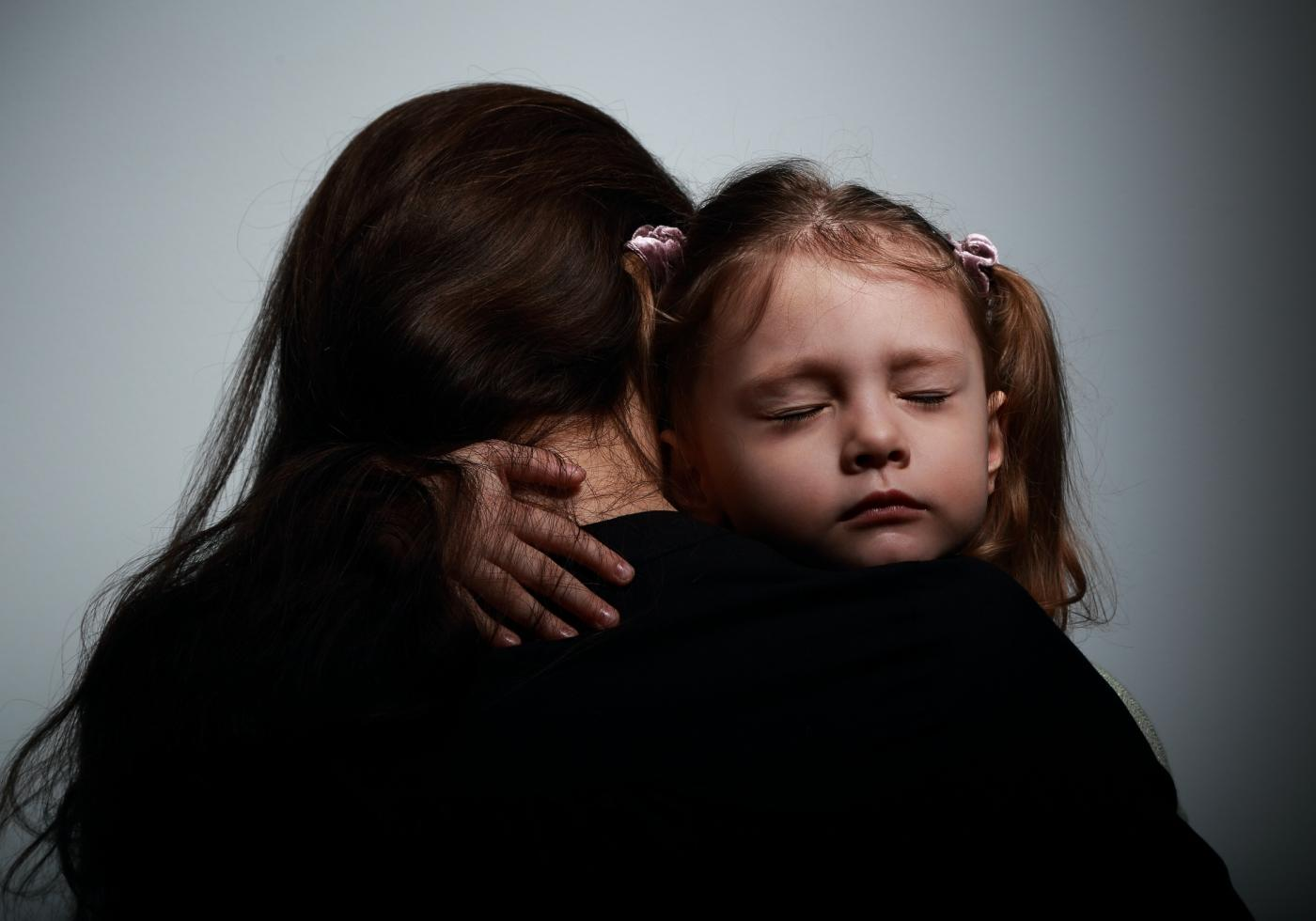 Young child being comforted by a social worker