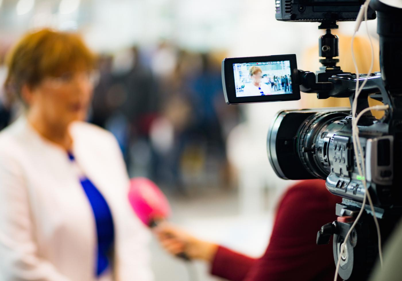 Lady being interviewed on camera