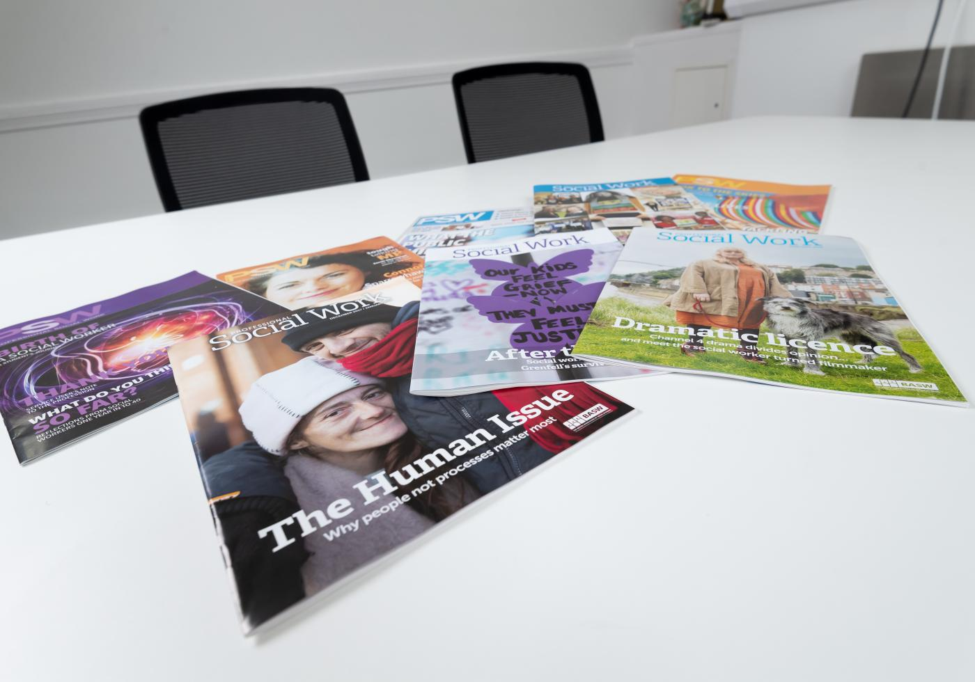 Professional Social Work Magazine on a table