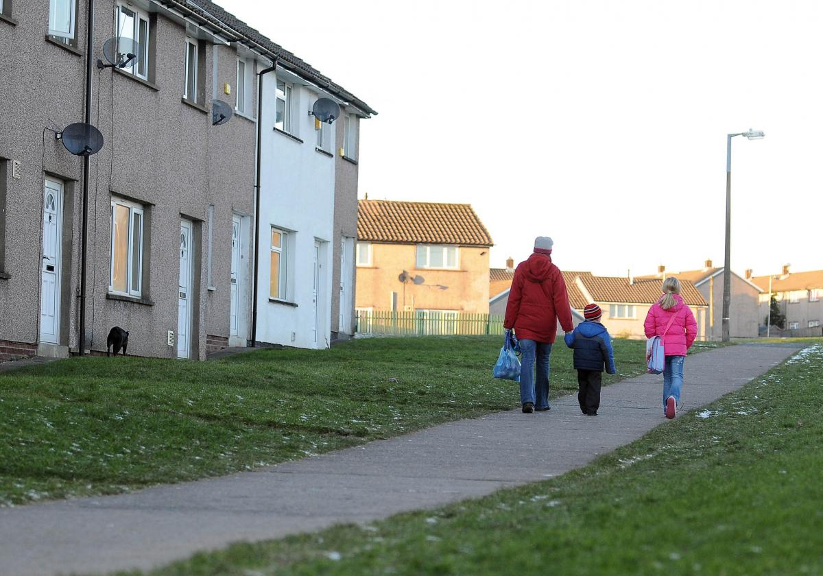 Housing estate with mother and two children