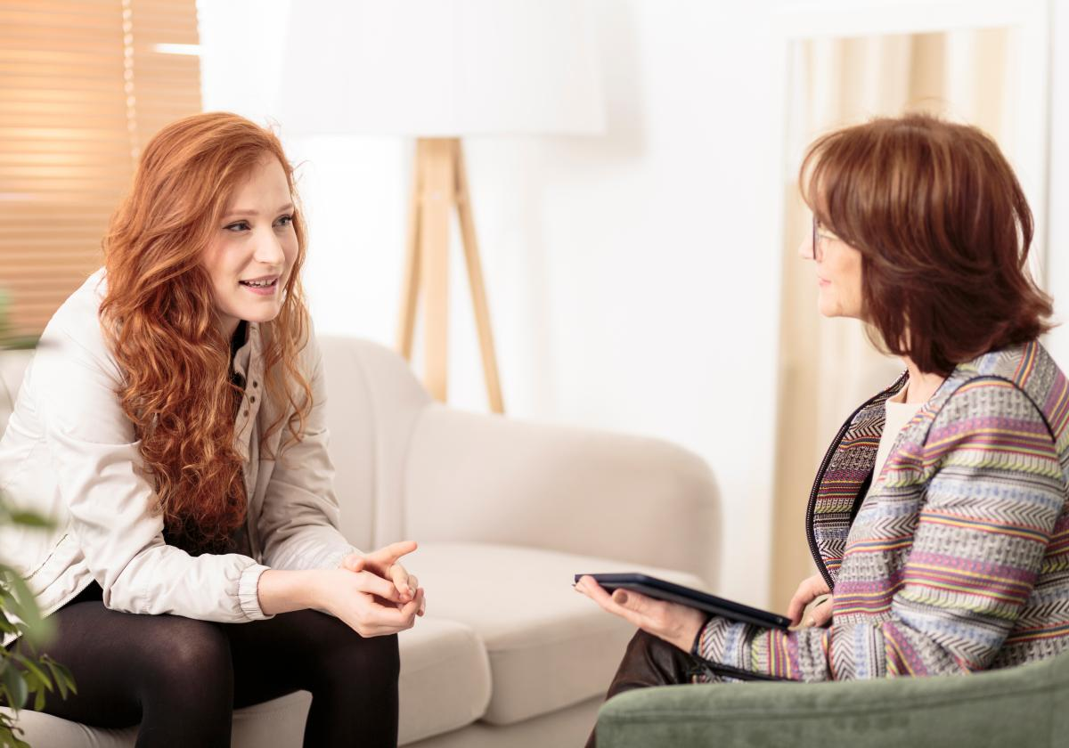 BASW Northern Ireland Mentoring Service. Two social work professionals in discussion.