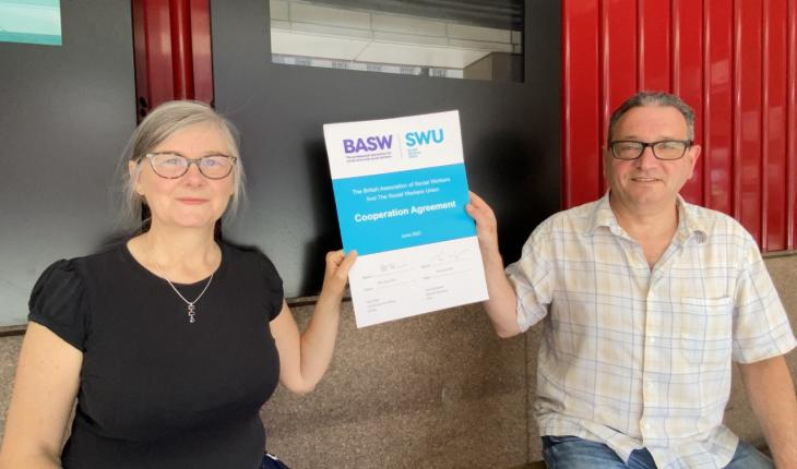 BASW Chief Executive Ruth Allen and SWU General Secretary John McGowan each hold a side of the new BASW/SWU Co-operation Agreement (signed 10 June 2021) while remaining socially distanced due to COVID-19 regulations.
