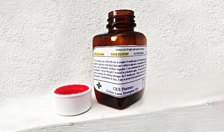 Pill bottle with social work story printed on