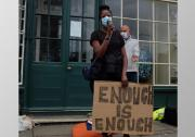 Amanda Takavarasha holding enough is enough placard