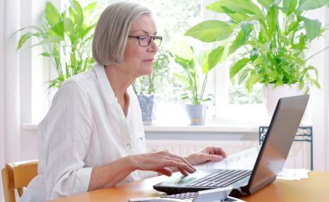 Woman filling in tax return
