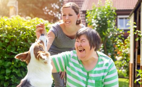 Social worker with autistic adult and autism dog