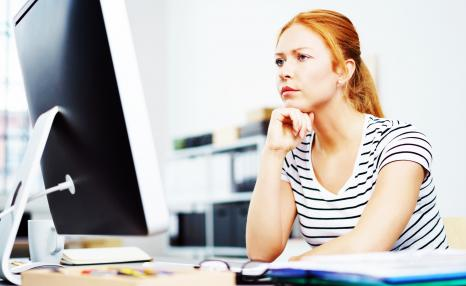 Critical reflection and analysis: Woman reflecting on something at computer screen