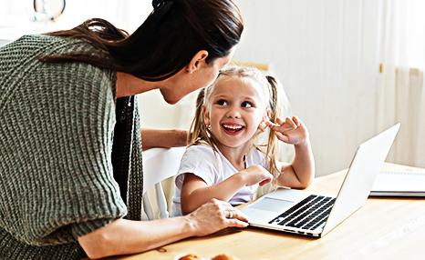 Social worker using laptop with child